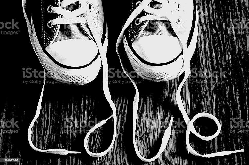 Creative photo of all star shoes with the shoe laces spelling love