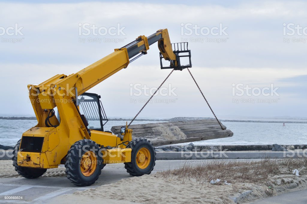 All Terrain Forklift Carrying Load stock photo