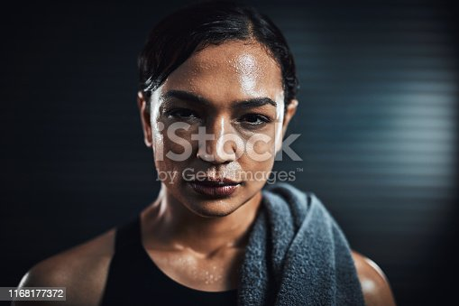 Portrait of a sporty young woman sweating after her workout