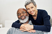 Cropped portrait of an affectionate senior couple relaxing on the sofa at home