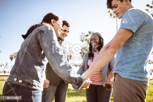 istock all together multiracial group holding hands 1138454607