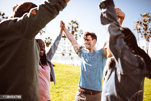 istock all together multiracial group holding hands 1138454789