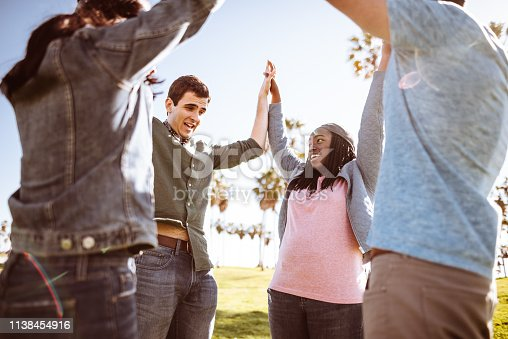 istock all together multiracial group holding hands 1138454916
