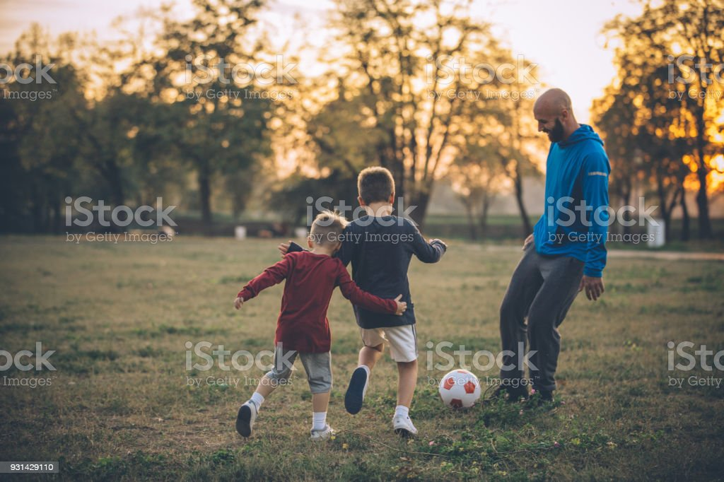 All we need is a soccer ball and part of green field stock photo