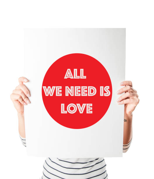 All we need is love placard stock photo