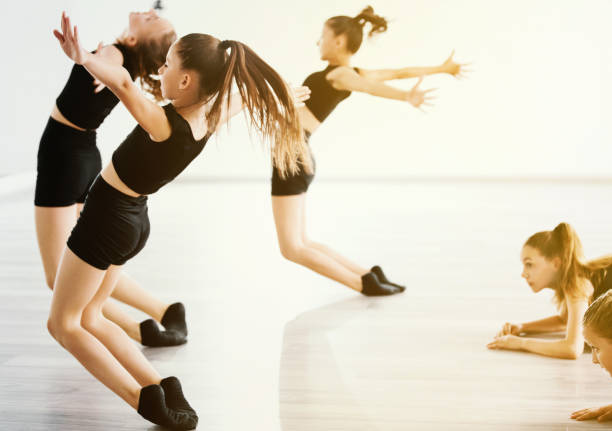 All we want to do is dance. Group of young dancers dancing together at dance class. dance studio stock pictures, royalty-free photos & images