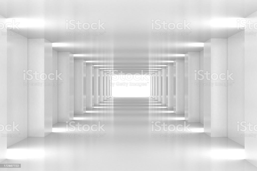 All white corridor ends in bright light stock photo