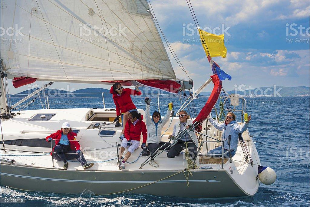 All women sailing team celebrating stock photo