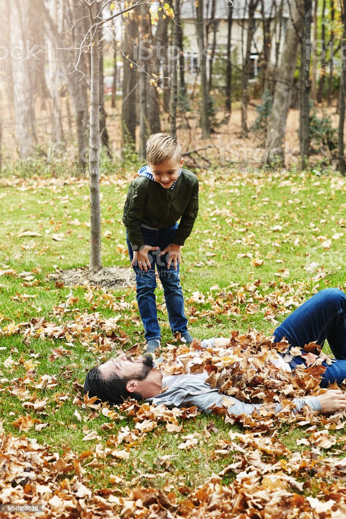 All you hear are giggles amongst the golden leaves - Royalty-free Adult Stock Photo