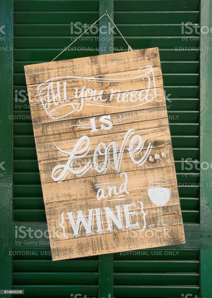 All you need is love and wine sign stock photo