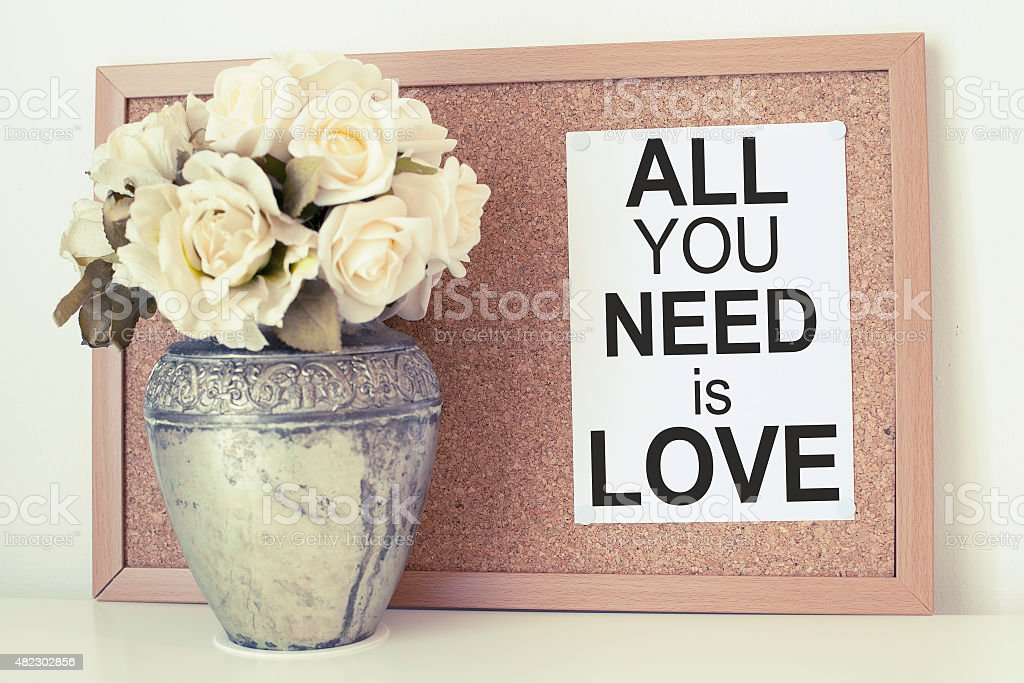 All you need is love note with flowers stock photo