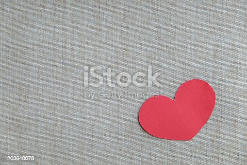 Focus on red heart shape on a white envelope with a red background