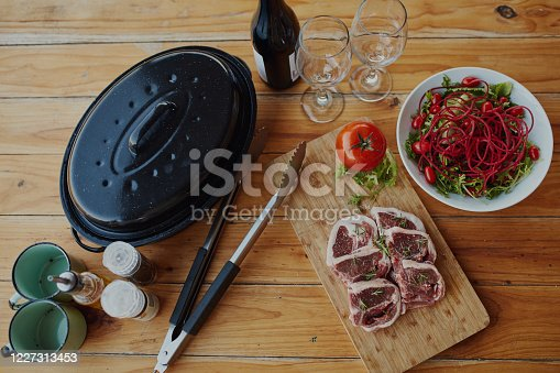 """Shot of delicious food with the words """"It's braai time"""" over it"""