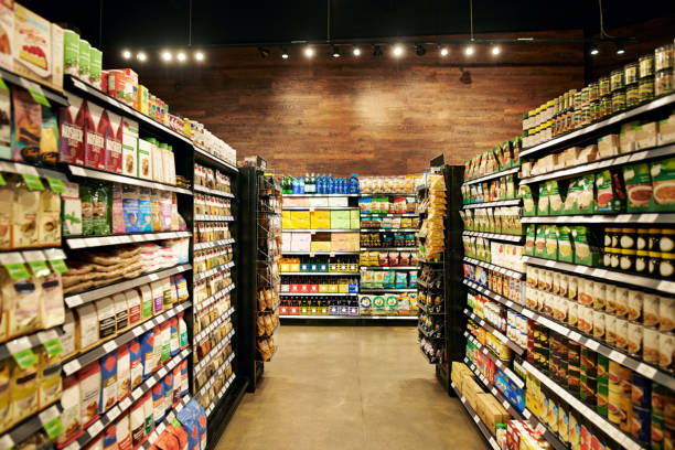 All your necessities stored in one place Shot of fully stocked isles in a grocery store during the day supermarket stock pictures, royalty-free photos & images