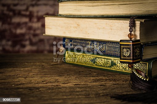 istock allah god of Islam with Koran - holy book of Muslims ( public item of all muslims ) on the table , still life 909822238