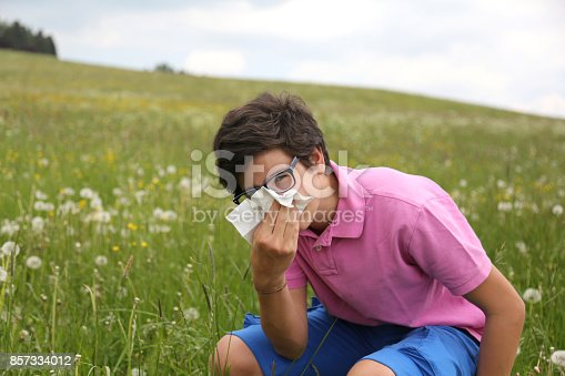 629307146istockphoto Allergic boy with glasses blows his nose 857334012