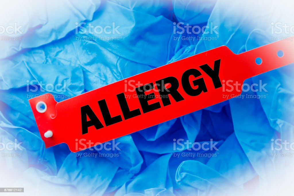 Allergy Bracelet Over Blue Protective Glove stock photo