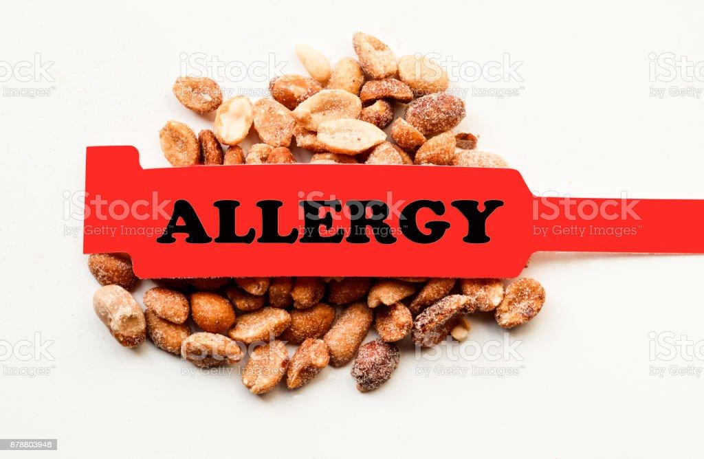 Allergy Bracelet Over Peanuts stock photo