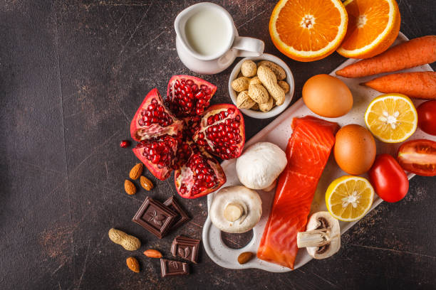Allergy food concept. Allergies to fish, eggs, citrus fruits, chocolate, mushrooms and nuts. stock photo