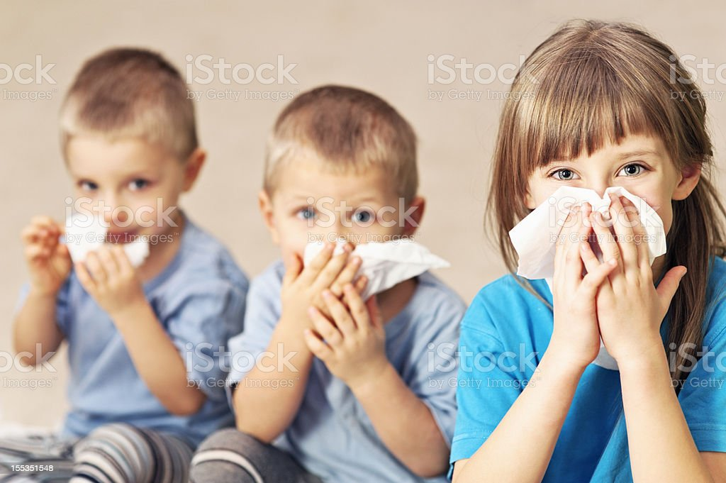 Kids cleaning their noses.
