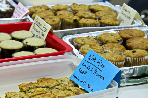 allergy items at a bake sale - food allergies stock photos and pictures