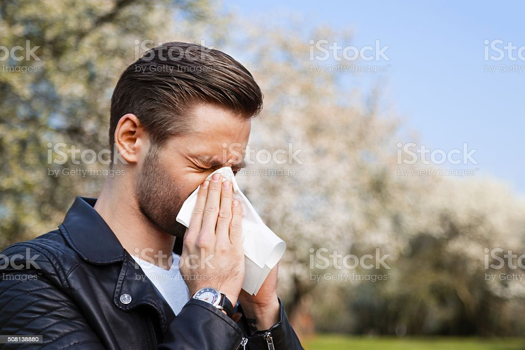 Allergy, man, springtime stock photo