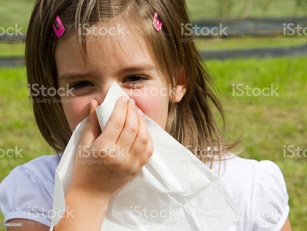 Little girl with handkerchief outdoor pollen allergy