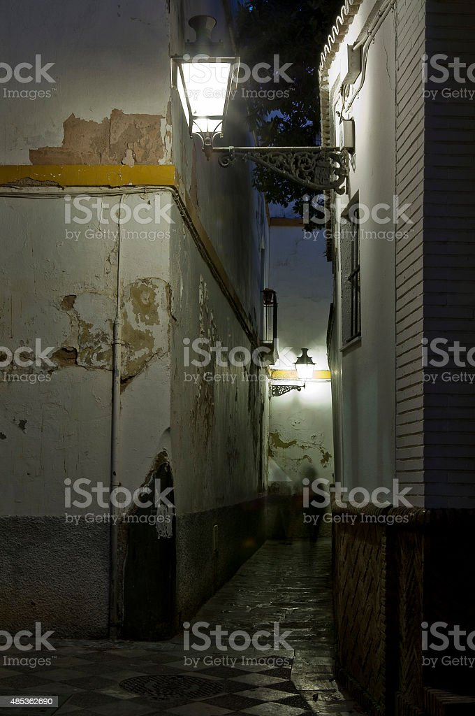 Alley at night in Old Seville stock photo