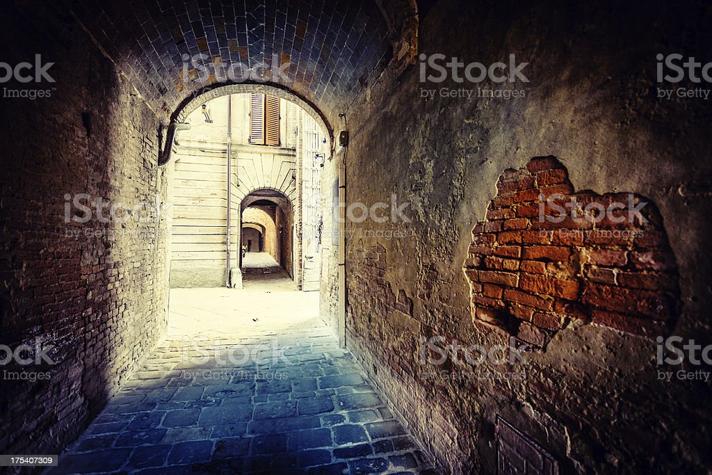 Alley in Medieval Town of Tuscany, Italy royalty-free stock photo