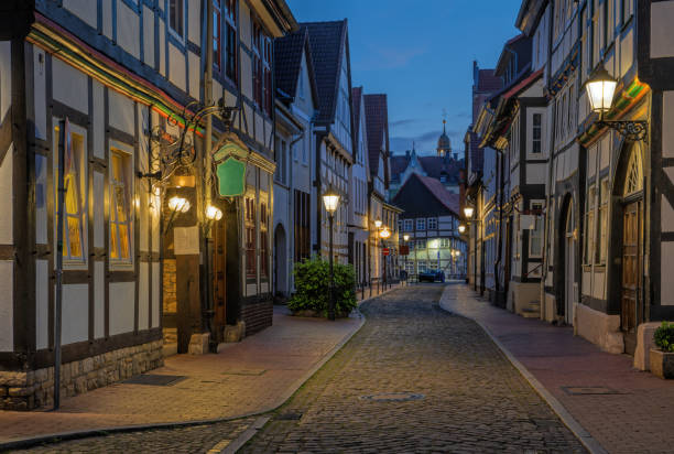 Alley in old town with traditional half-timbered houses in town of pied piper, Hameln, Lower Saxony, Germany at dusk stock photo