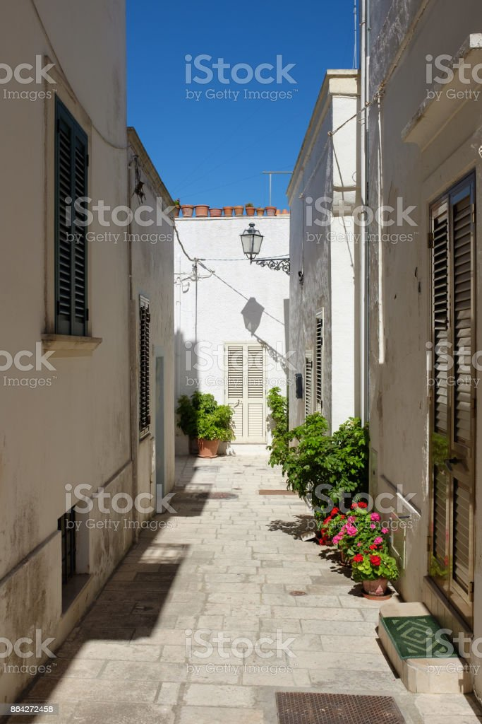 Alley of Castro village in a summer day. Salento, Italy royalty-free stock photo