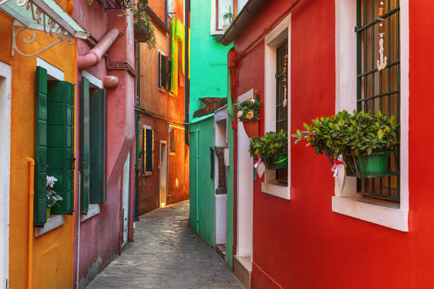 Alley of Colorful Buildings of Burano, Venice, Italy stock photo