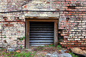 an alley wall with access chute vent