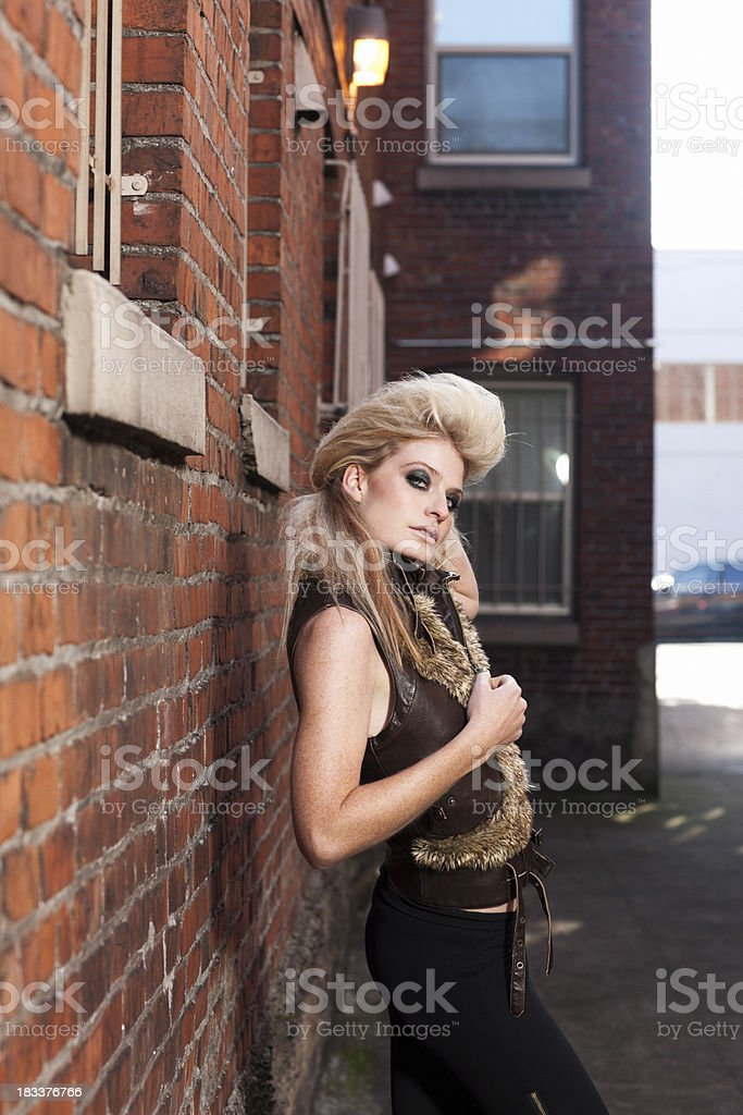 Alley Way with Beautiful Blond Fashion Model in Vest stock photo