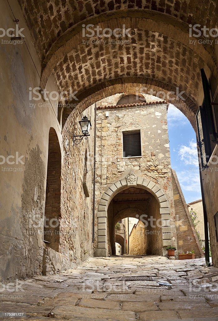 Alley With Arches In Medieval Village, Tuscany Italy stock photo
