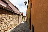 Alley with houses in small town of Rothenburg ob der Tauber, Germany.