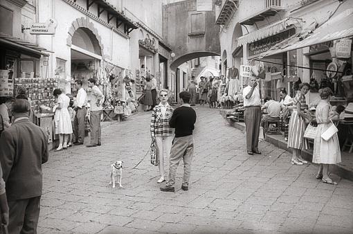 Anacapri, Capri, Campania, Italy, 1958. Alley with souvenir shops in Anacapri. Furthermore: tourists and locals.