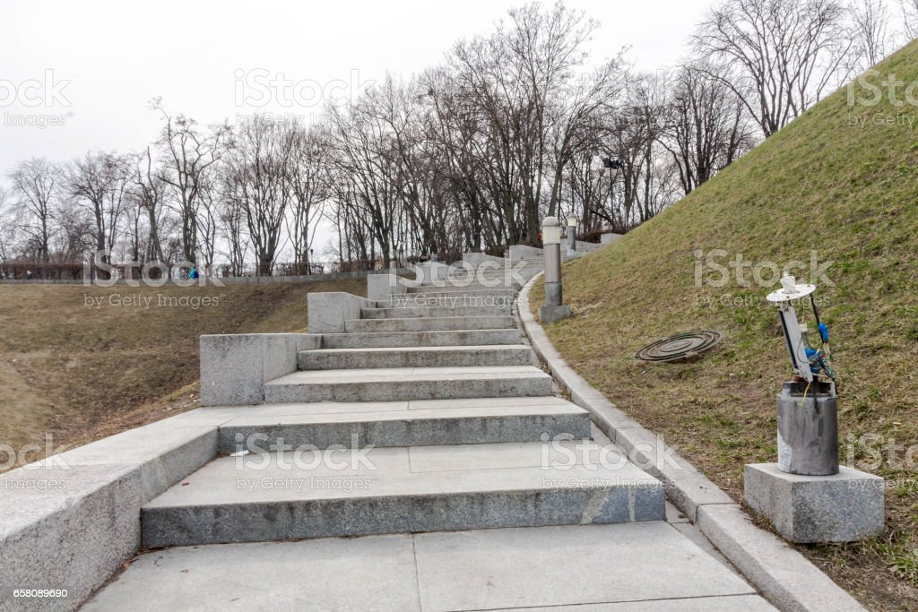Alley with stairs in the park. Stairs up. royalty-free stock photo