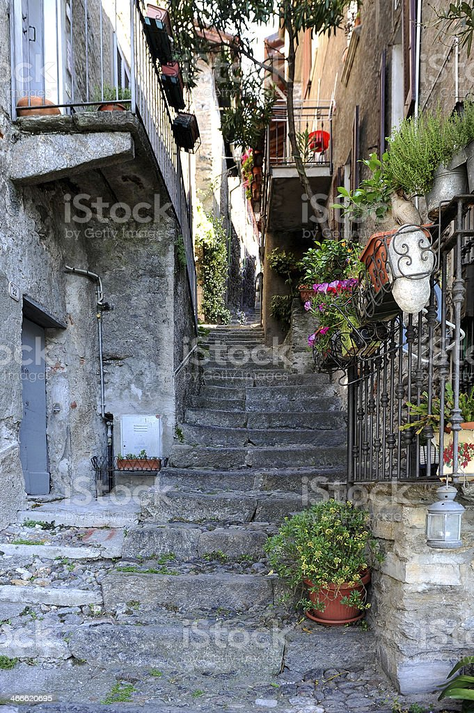 Alley with steps in the Italian town of Corenno Plinio stock photo