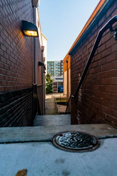 alleyway between city buildings stock photo