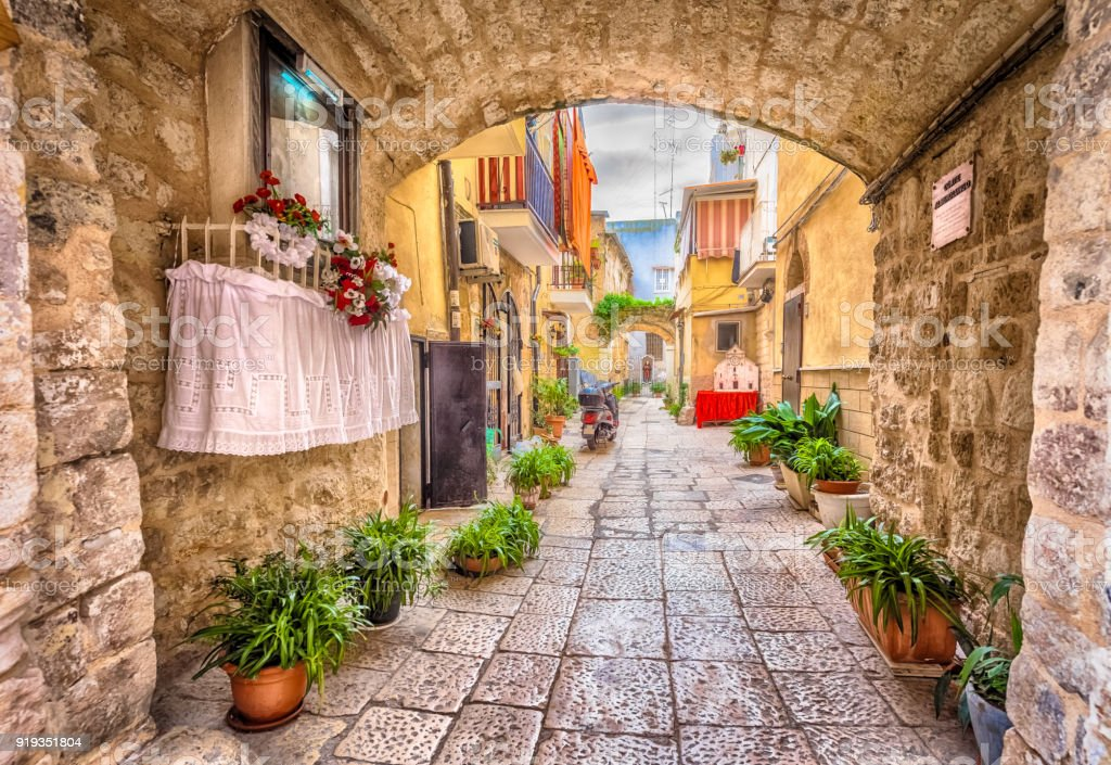 Alleyway in old white town Bari stock photo
