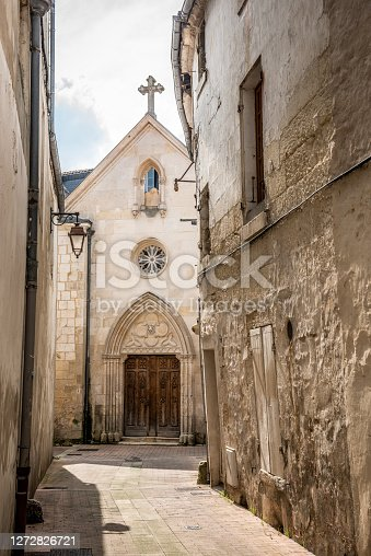 istock Alleyway Leading To Church in Saintes Poitou-Charente, France 1272826721