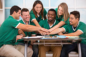 istock All-for-one. Team of volunteers show unity during event planning. 502785811
