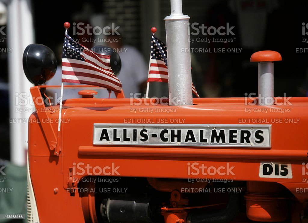 Allis-Chalmers Tractor with American Flags in Parade royalty-free stock photo