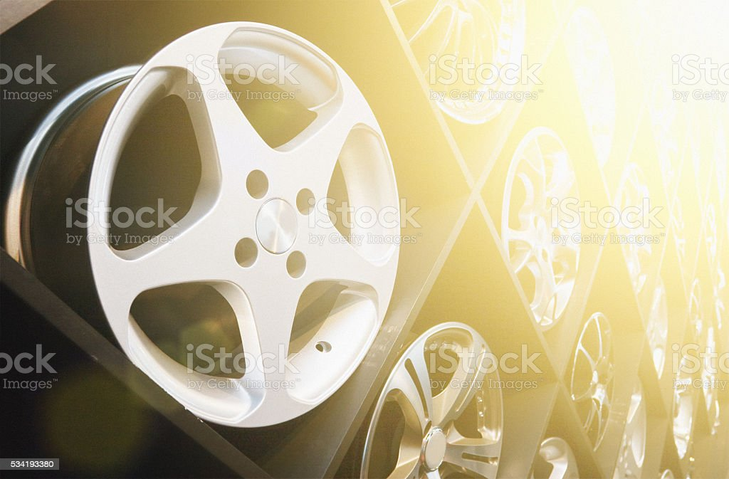 Alloy mag wheels rims stacked on display in store shop stock photo