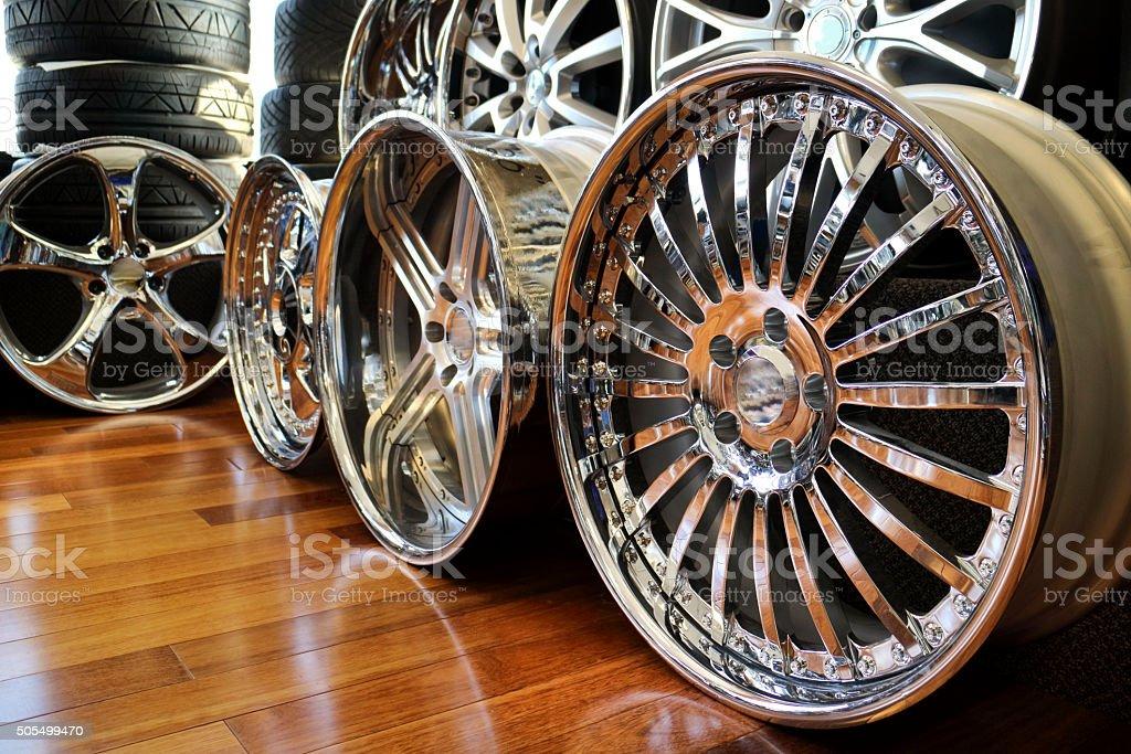 Alloy rims on showroom floor. Chrome, aluminum plenty car bling stock photo