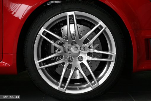 Detail view of a red sports carA's alloy wheel.