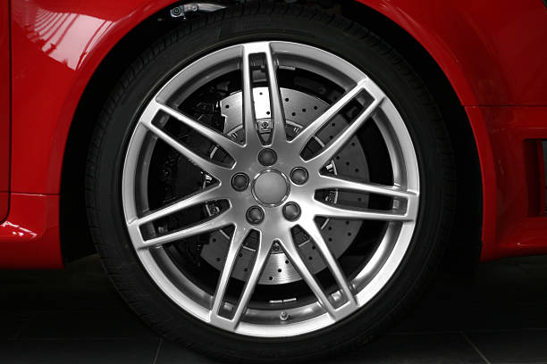 Alloy wheel close up of red sportive car stock photo