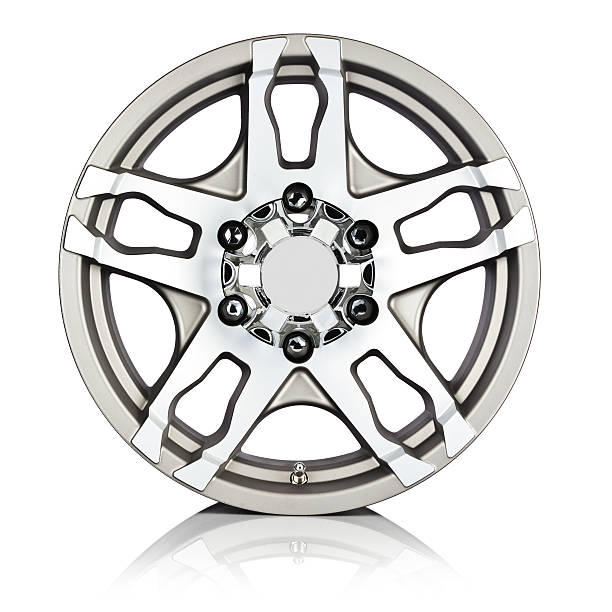 Alloy wheel isolated on reflective white backdrop. Front view stock photo