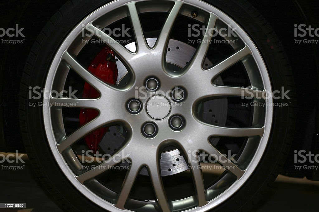Alloy wheel of a sports car with red brakes stock photo